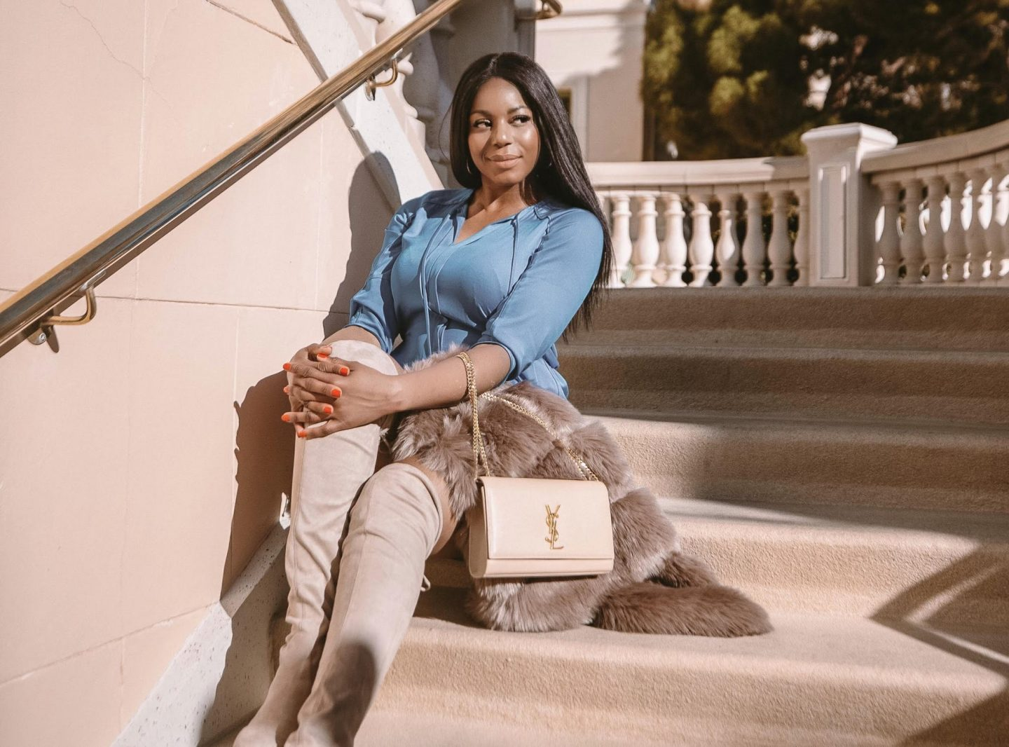Fashion Blogger Kaye Bassey wearing a Blue DVF Dress & Saint Laurent Logo Bag in Las Vegas