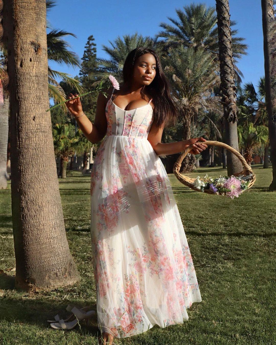 Kaye Bassey in a BCBG floral maxi dress at the park