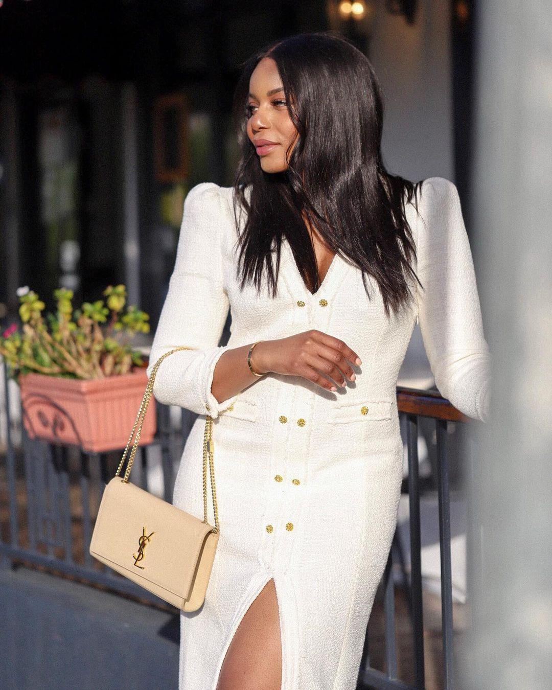 Kaye Bassey in white dress and YSL handbag - capsule wardrobe ideas