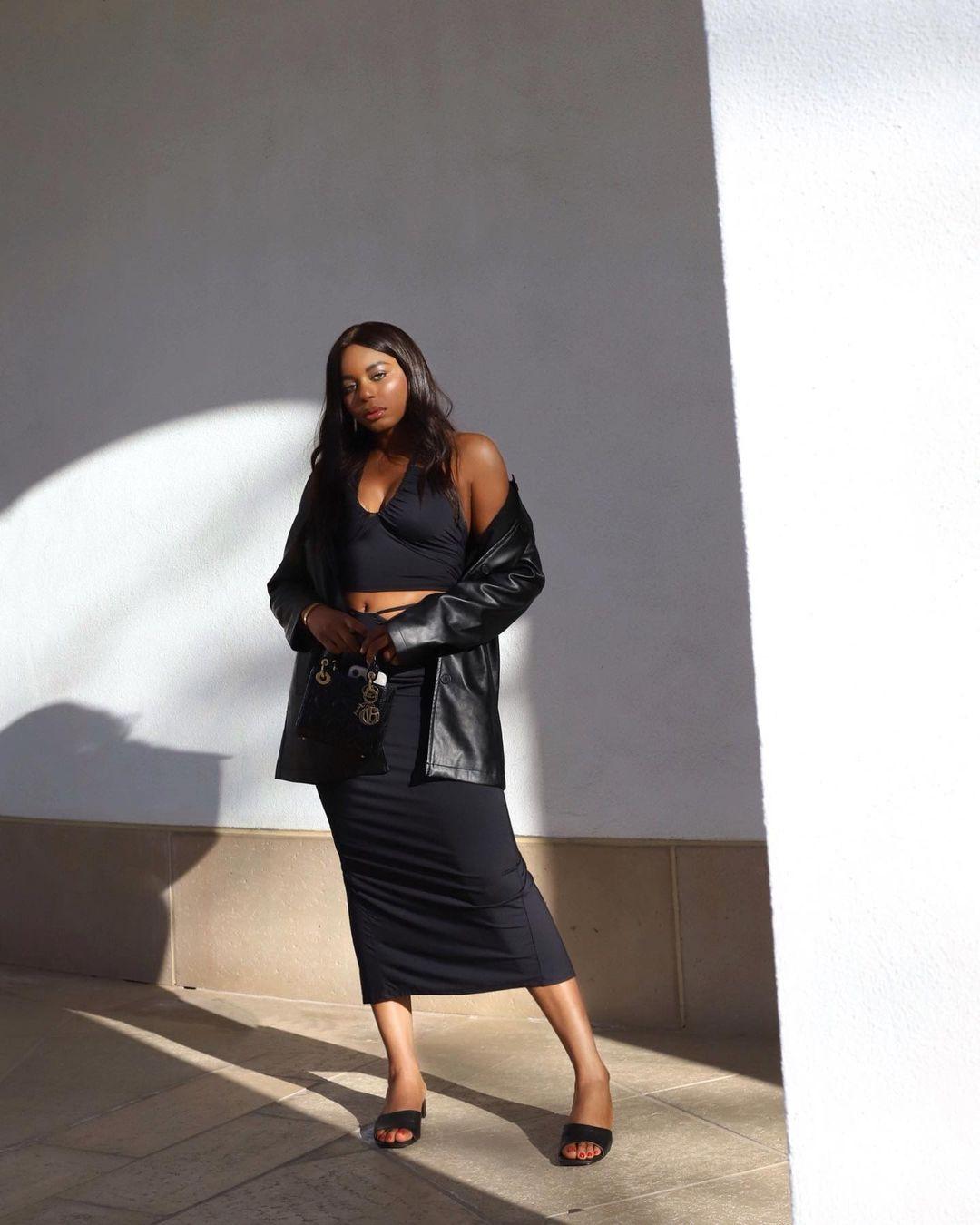 Model, Kaye, in leather blazer and black midi skirt