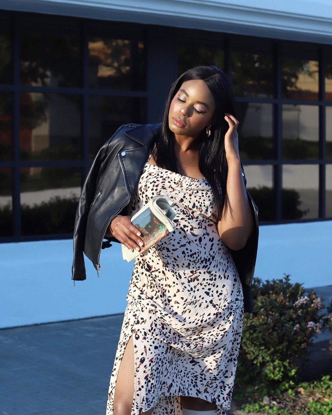 Kaye Bassey in an animal print dress and leather Moto jacket