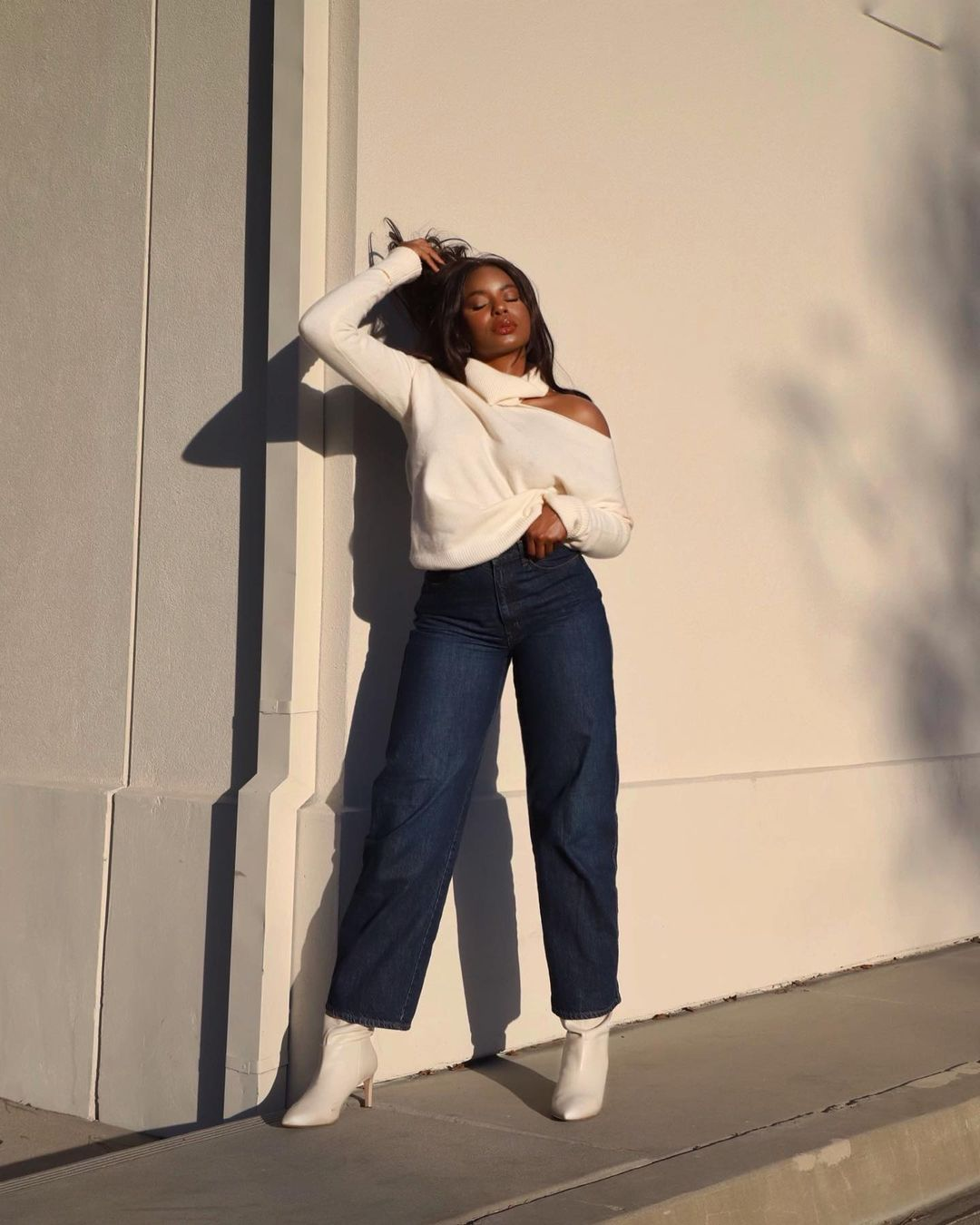 Kaye Bassey in Paige cut out sweater, denim crops and white boots for pre-fall fashion