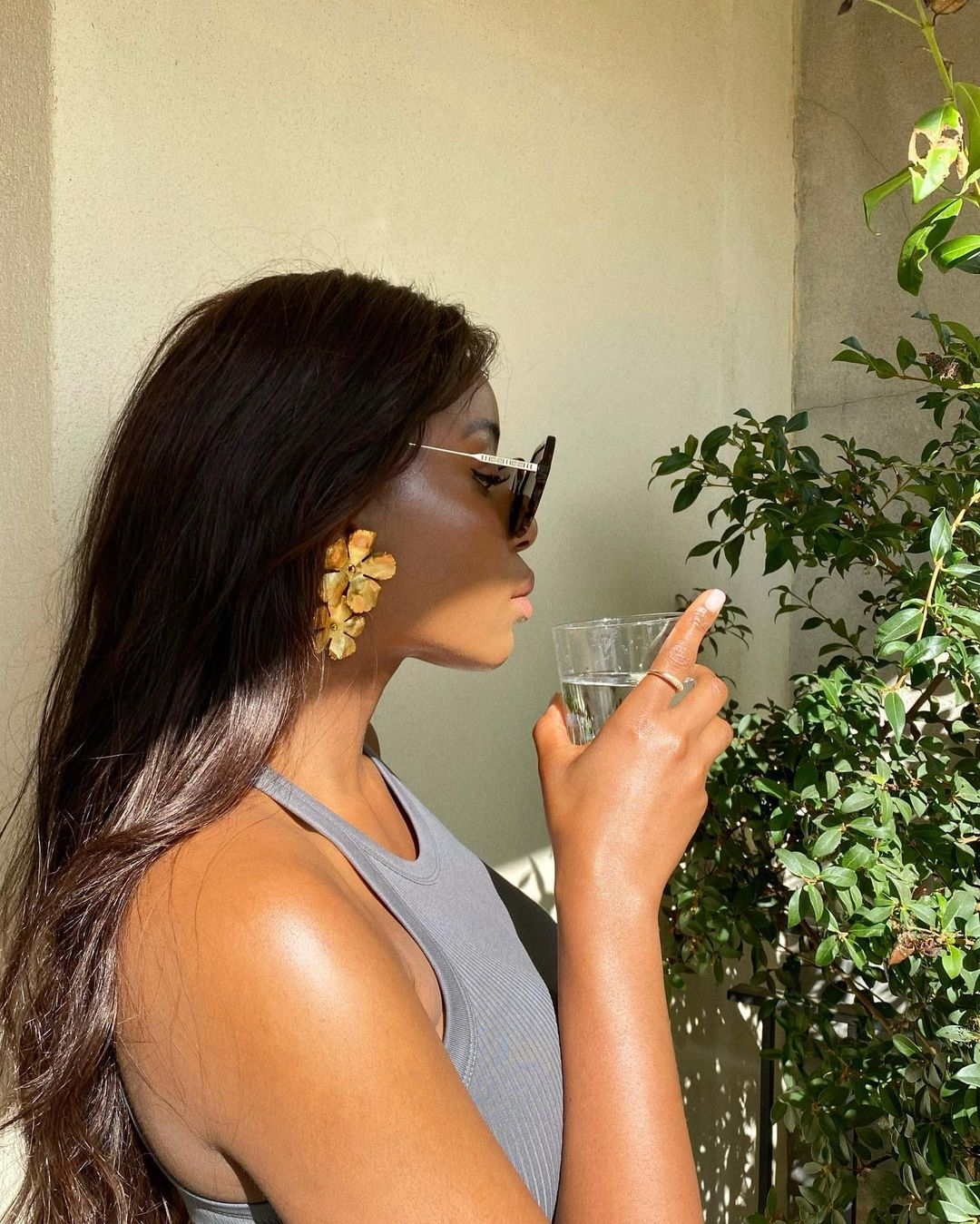 Wearing Burberry sunglasses, Jennifer Behr Colette earrings, Stone & Strand diamond orb ring, Nordstrom Stretch organic cotton rib tank with long, effortlessly wavy hair (hair protection tips)